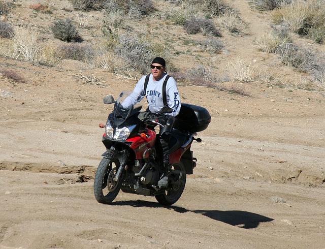 Motorcyclist Climbing Mengel Pass (9710)