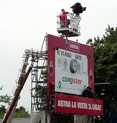 Scoreboard with TV-team on crane