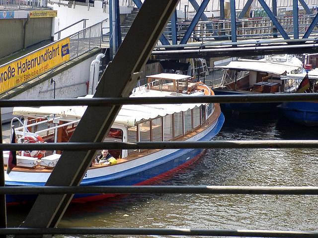 Barge with men behind bridge