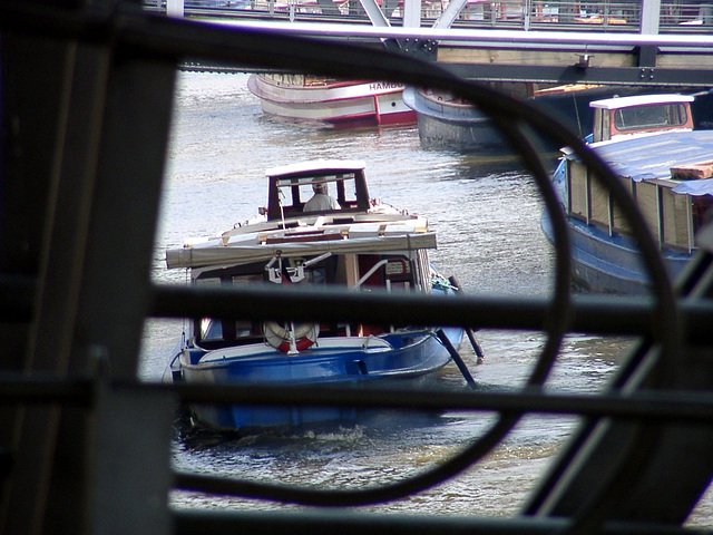 Barge behind bridge