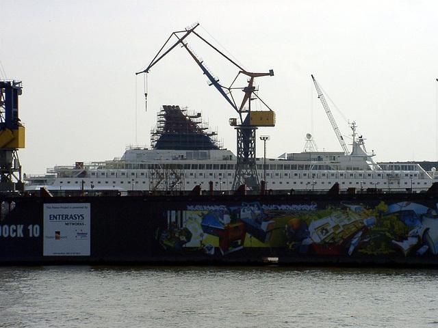 Crane, graffiti and little yacht