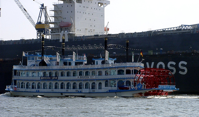 "Paddle wheel steamer ""Louisana Star"" in front of docked ""Yokohama Senator"""