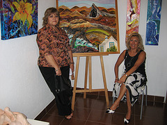 Espaço AmArte, painter Micéu (left) exhibition with Maria da Nazaré, gallery director
