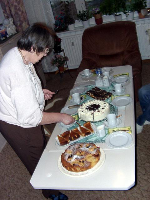 My grandma cutting the Schwarzwalder