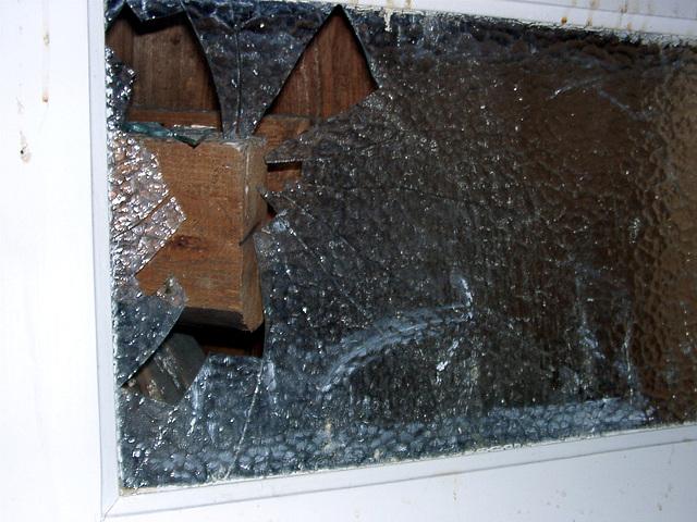 Broken window, by a craftsman