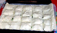 Filo dough filled with goat cheese and spinach leaves
