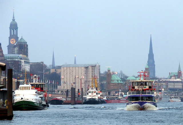 Hamburg Skyline with ferry and some tugboats