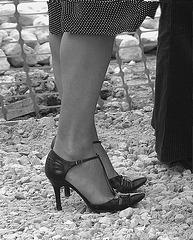 My friend Rachel with permission  /  Mon ami Rachel en talons hauts avec sa permission - My shoes - building site. by Mandy - B & W.