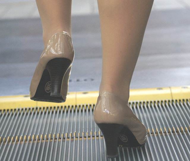 heels on escalator