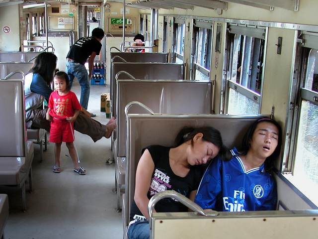 Passenger in a regional train, Thailand
