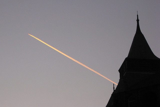 Vapour trail at twilight