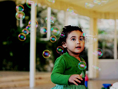 Rafaela, playing with soap bubbles