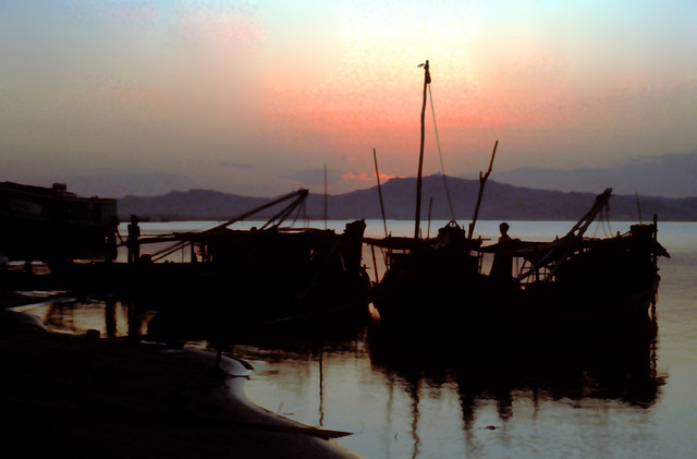 Fishing boats in sunset on the Irrawaddy, Burma