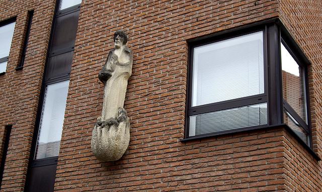 Sandsteinfigur an einem Gebäude in Coesfeld