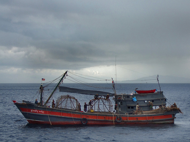 Burmese fishing boat crossing the route