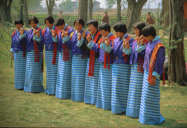 Dancing women in their traditional Kira