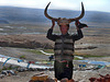 Siri our Tibetan driver shows a carved Yak horn
