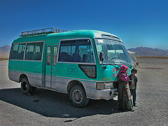 Tibetan kids in front of an overland bus