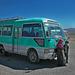 Tibetan kids in front of an overland bus