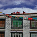 Monks on a rooftop in the Tibetan quarter of Lhasa