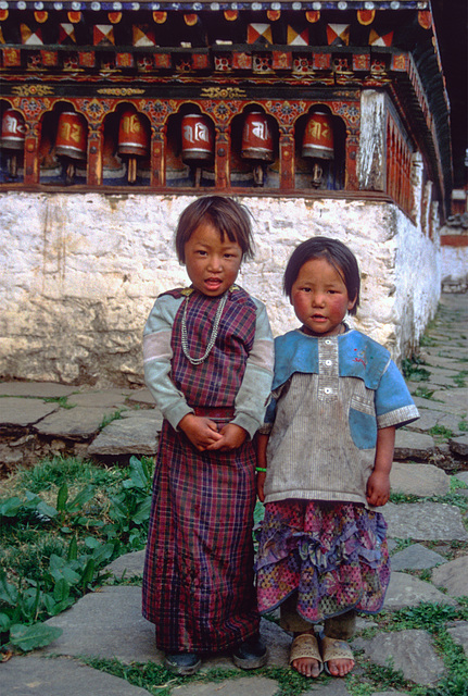 Bhutanese little ladies in the yard of the monastery