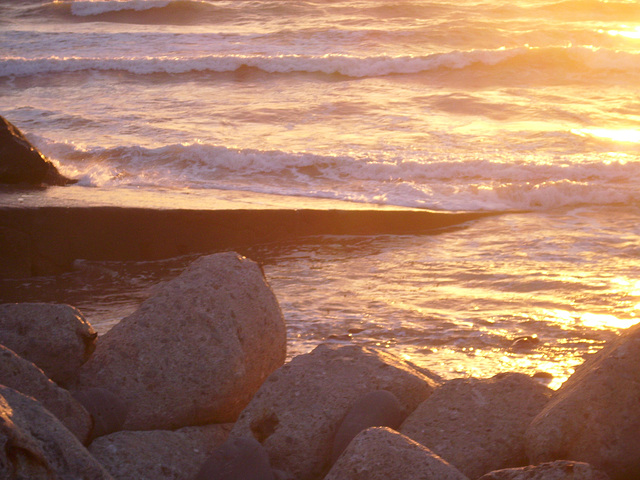 The brilliance of the setting sun on the waves