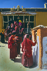 Pilgrims step in the Toling Monastery