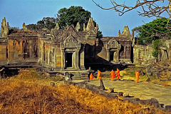 Monks entering the Gopura complex