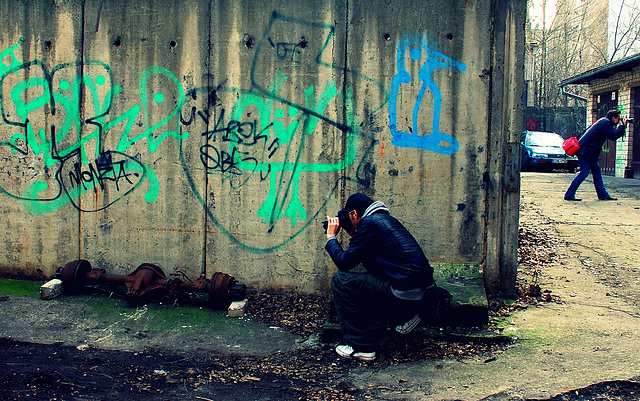 2 photographers and the wall