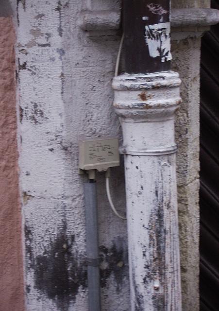 telephone line meets rain pipe