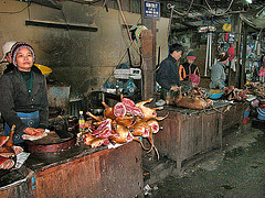 Dog meat butcher at a market in Hanoi