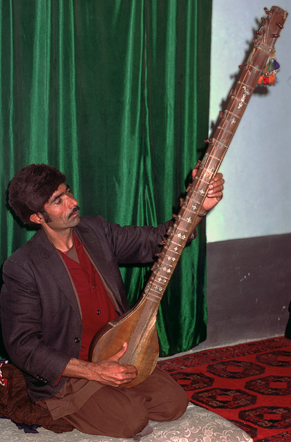 Afghanian musician plays his instrument