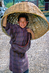 Young boy using his basket as an hat