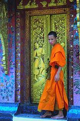 Monk exits Wat Xieng Thong main temple