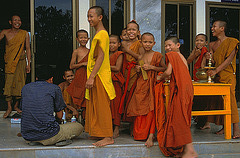 Laotian monks in a monastery beside the Mekong