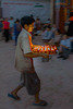 Boy brings new lighted butter lamps