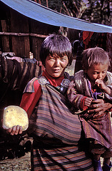Bhutanese herds woman selling cheese