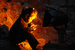 Child in front of a floodlight