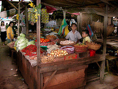Vegetable vendor girls at the market in Pakse
