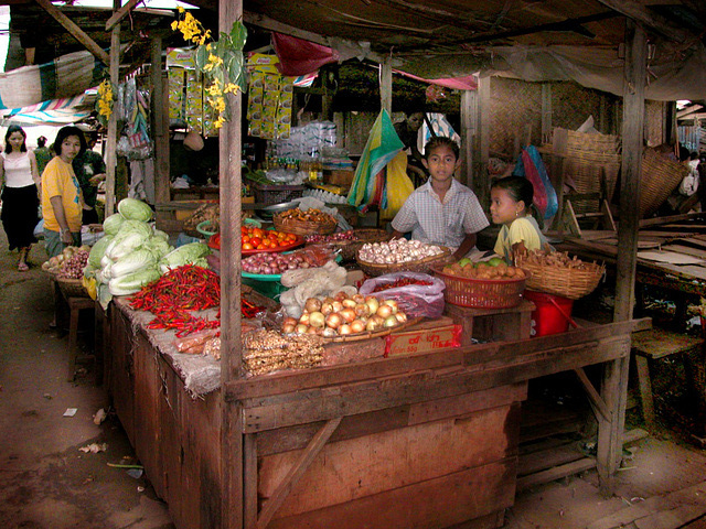 Vegetable vendor girls at the market in Pakse