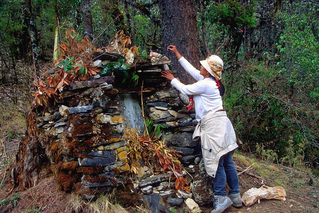 Setting a stone onto the Mani Wall
