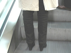 Heras blond mature in extreme hammer heeled boots-  Brussels airport -19-10-2008