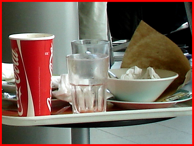 Coca-cola and water leftovers / Plateau collation à la Coca-cola - Schiphol airport.