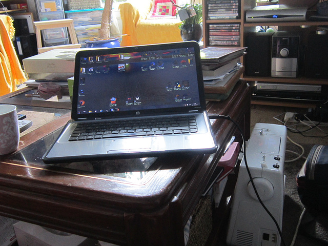 My laptop on the coffee table & my sewing machine
