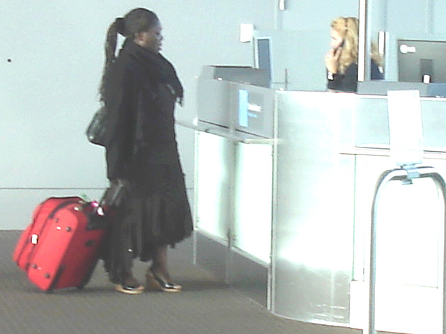 Ponytail Black Lady in wedges -  Brussels airport  / October 19th 2008