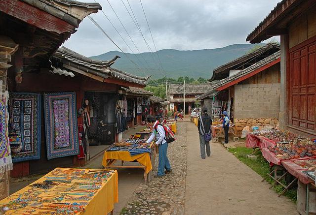 Selling souvenirs in the Naxi village Baisha