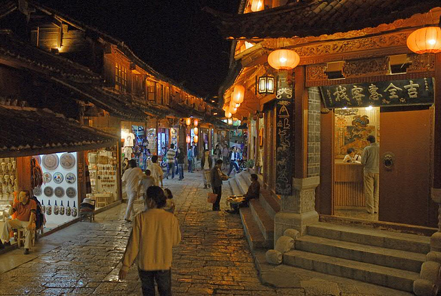 Red lanterns reflected in the alley at night