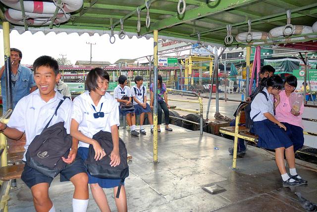 School pupils cross the Chao Phraya