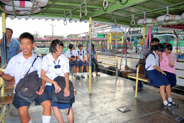 School pupils cross the Chao Phraya