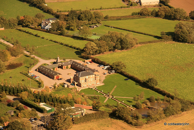 Aerial - Bentley's farmhouse (?), from 1029 feet above Whitley Village Hall, looking east